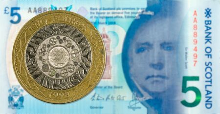 2 Pounds coin against 5 Pounds Sterling note issued by Bank of Scotland reverse