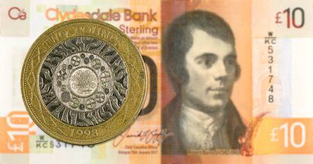 2 Pounds coin against 10 Pounds Sterling note issued by Clydesdale Bank PLC reverse