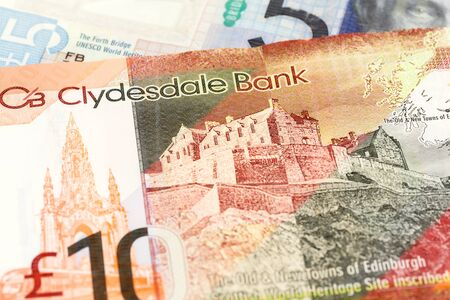 detail of 5 and 10 Pounds Sterling notes issued by Clydesdale Bank PLC Imagens