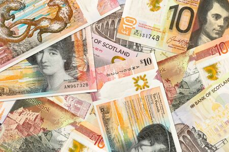 some different 10 Pounds Sterling banknotes issued by Scottish Banks