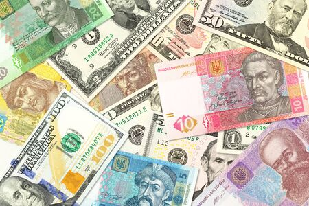 some ukrainian hryvnia banknotes and american dollar banknotes mixed indicating bilateral economic relations