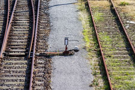 overgrown tracks and rail switch with old wooden planks, Loebau, Saxony, Germany