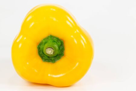 detail of a yellow capsicum fruit illustrating a healthy lifestyle isolated on white background