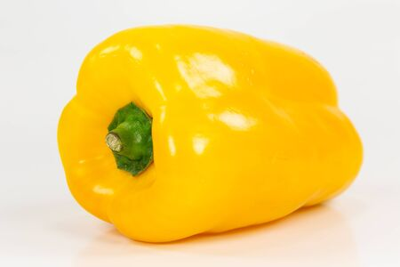 yellow capsicum fruit illustrating a healthy lifestyle isolated on white background Reklamní fotografie - 150500168
