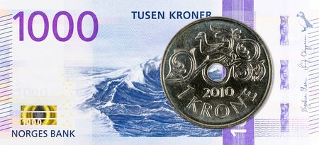 1 norwegian coin against new 1000 norwegian krone bank note obverse