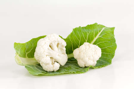 delicious white cauliflower with leaves illustrating a healthy lifestyle