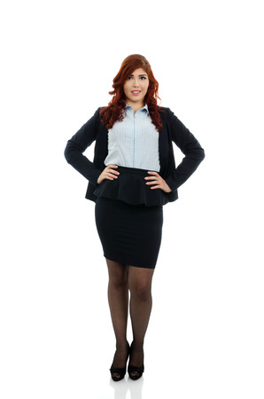 Redhead business woman with hands on waist photo