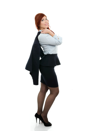 Successful business woman with coat over her shoulder photo