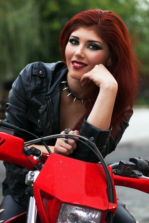 Beautiful smiling biker chick