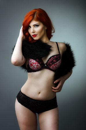 Sensual plus size model posing in sexy lingerie photo
