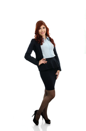 Young business woman with hand on waist over white background photo