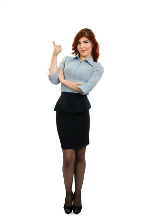 Young busines woman giving thumbs up isolated on whie background photo