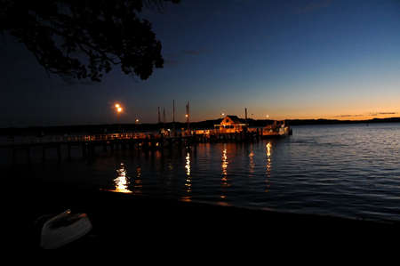 Night shot of a colorful wharf. With the sun setting in the back. photo
