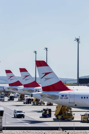 arrive: Austrian Airline planes lined up a busy Saturday at Vienna International Airport