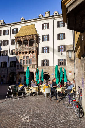 sforza: INNSBRUCK, AUSTRIA - NOVEMBER 1st 2015: The Golden Roof, completed in 1500, ornamented with 2,738 fire-gilded copper tiles for Emperor Maximilian I to mark his wedding to Bianca Sforza Editorial