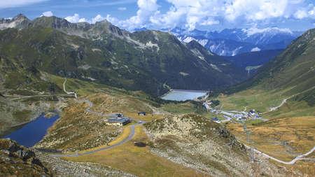 The high mountains of the Austrian Alps in Kuhtai during summer season. The sunshine illuminates the beautiful landscape.