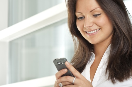 Portrait of businesswoman using a cell phone Stock Photo - 10598719