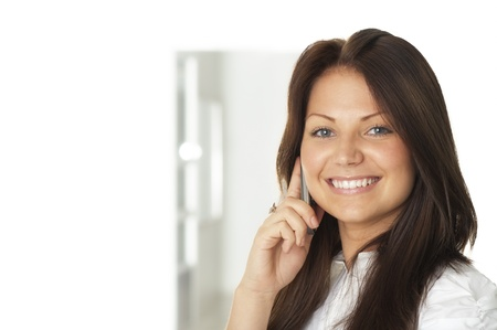 Portrait of businesswoman talking on cell phone Stock Photo - 10627381
