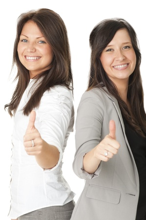 Portrait of two businesswomen showing thumbs up Stock Photo - 10671635