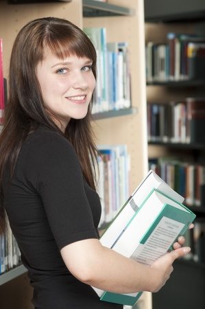 studing: Portrait of young student studing at library Stock Photo