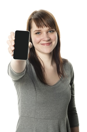 Woman holding out a cell phone on white background Stock Photo