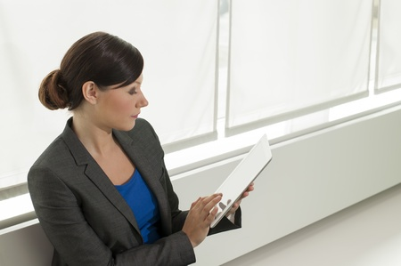 Business woman using a tablet computer at the office