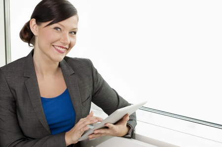 Business woman using a tablet computer at the office Stock Photo - 13380644