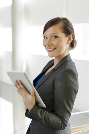 Business woman using a tablet computer at the office Stock Photo - 13380643