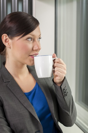 Business woman drinking coffee at a break
