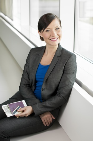 Traveling business woman going on a trip Stock Photo