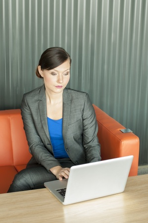 Business woman using a laptop at the office