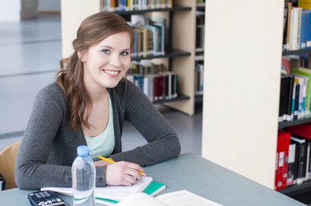 Portrait of female student studying at the table Stock Photo - 13633364