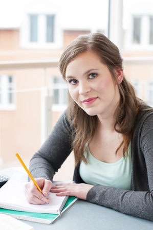 Portrait of female student studying at the table