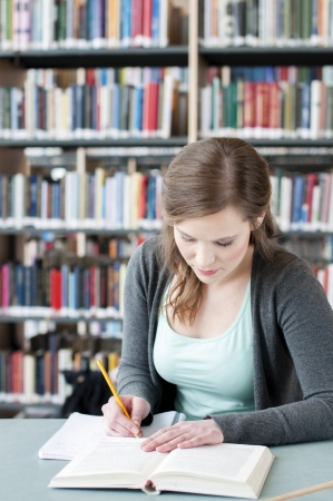 Portrait of female student studying at the table Stock Photo - 13861855