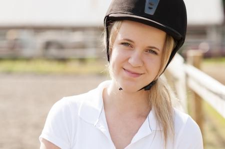 Portrait of female horse rider