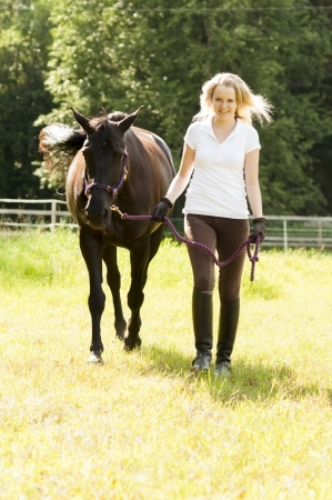 Portrait of female horse rider and horse