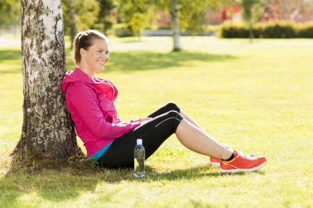 Happy woman jogger training in the park. Healthy lifestyle and physical exercise feels good.