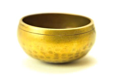 Bronze meditation singing bowl isolated on white background.