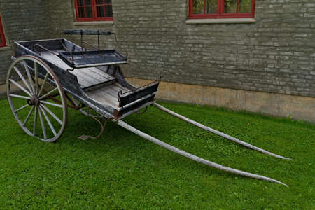 And old wooden two wheeled horse cart, used for transportation of goods and people.