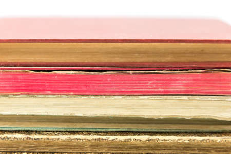 Pile of old vintage books isolated on white background