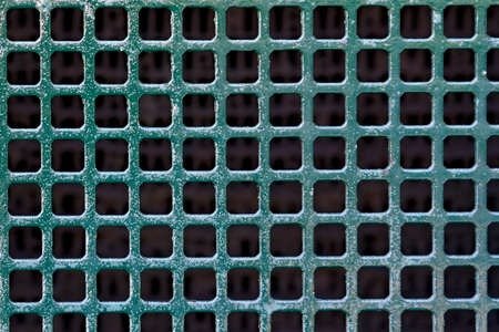 Green metal mesh texture of an old automotive cooler. . High quality photo