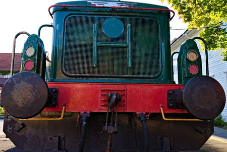 Old diesel locomotive seen from the front. . High quality photo