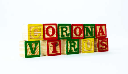 Colorful wooden alphabet blocks spell out the words Corona virus. Isolated on white background. High quality photo