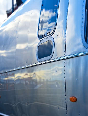 Classic American aluminum camper from the side.