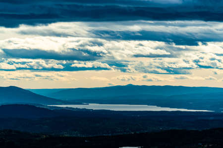 Morning view over Norwegian mountains with a large fjord in the distance. . High quality photo
