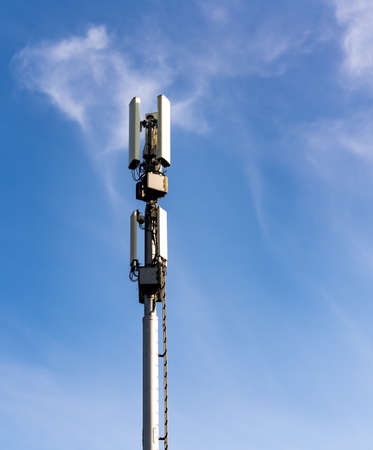 Cellular communications mast with various telecom devices. . High quality photo
