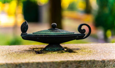 Old brass oil lamp sculpture green with patina. . High quality photo Standard-Bild