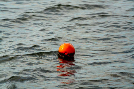 Orange buoy marker, marking the location of a crab pod left by a fisherman. . High quality photo Stok Fotoğraf