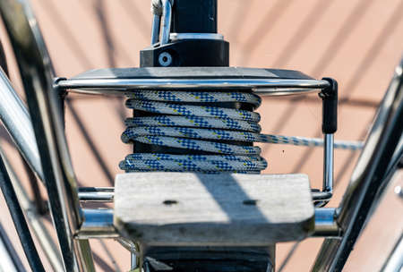Roller furling on the bow of a sailboat to control the jib sail from the cockpit of the vessel. Close up. . High quality photo Stock Photo
