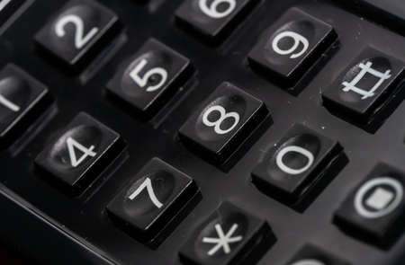 Close up of numerical dial buttons on an old analog phone. Shallow depth of field. High quality photo